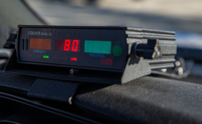The speed detector in Josh Nezi's police cruiser clocks a driver at 80 miles per hour Monday, October 14, 2019. The driver was issued a ticket. The Erlanger Police Department is part of a traffic enforcement blitz along Interstate 71/75 in Northern Kentucky.