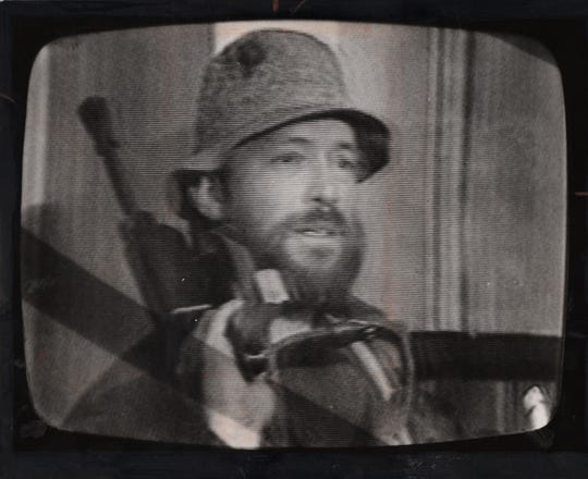 OCTOBER 16, 1980: James Hoskins, photographed from a Channel 9 television transmission, ended the TV station siege with suicide.