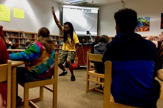 Armah gets Kenwood Middle School students to engage in the writing process.