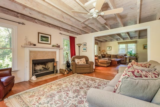 A covered front porch, dormered rooflines and window boxes lend country appeal to a renovated and completely updated vintage Colonial in Lebanon Township for sale for $475,000.