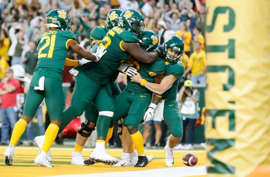 Baylor players celebrate in the end zone following a double-overtime victory over Texas Tech on Saturday.