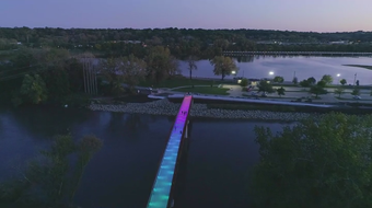 Lights are tested on the new pedestrian bridge connecting Gray's Lake to downtown Des Moines.