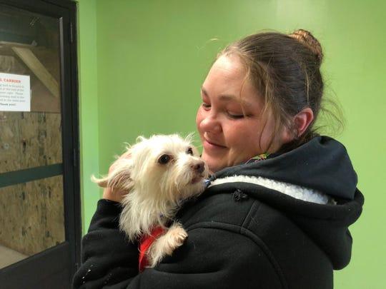 Tatiana reunites with her dog Jasper.