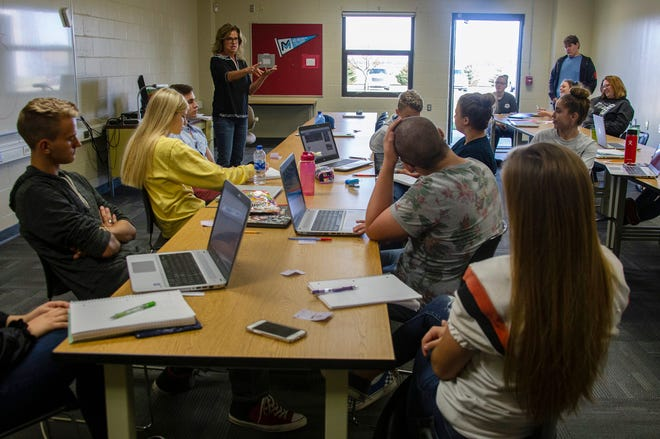 Julie Carr, an adjunct professor of speech from Mid-Michigan Community College addresses her class at Huron Area Technical Center Thursday, Sept. 19, 2019. Classes are offered by Mid-Michigan Community College at Huron Area Tech Center in Bad Axe despite the college being 120 miles away. It's a move by the college to help get higher education in areas without access to higher education.