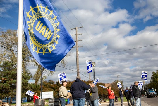 Strikers walk the line at Romulus Powertrain, Monday, Oct. 14, 2019.