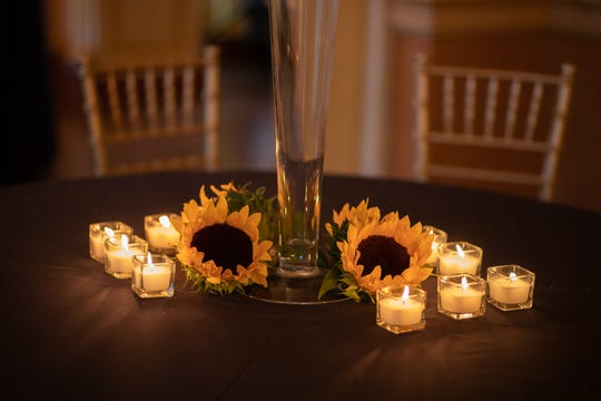 A sunflower theme throughout the venue keeps the overall look cohesive.