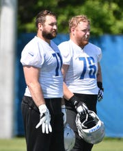 Former Lions offensive lineman T.J. Lang (76) remains in constant contact with his former teammates.