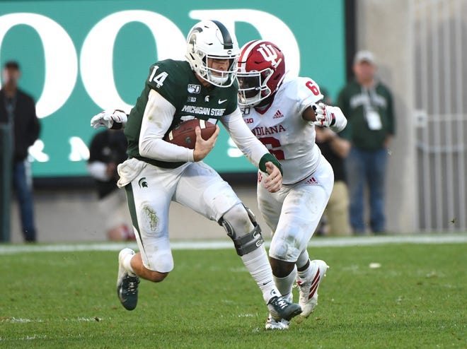Quarterback Brian Lewerke (14) and Michigan State will play host to Penn State at 3:30 p.m. Oct. 26. The game will be televised on ABC.
