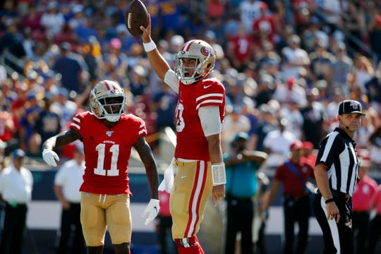 San Francisco 49ers quarterback Jimmy Garoppolo (10) celebrates after scoring a rushing touchdown against the Los Angeles Rams during the second half.
