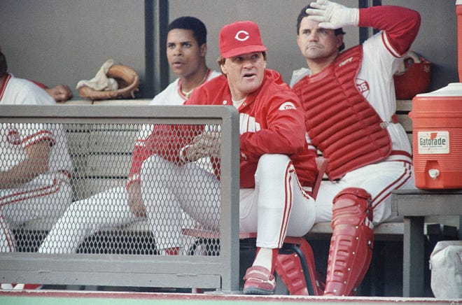 Cincinnati Reds manager Pete Rose watches the action from the dugout at Riverfront Stadium in 1989 during their National League game with the Atlanta Braves.
