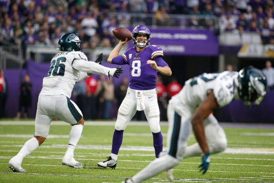 Minnesota Vikings quarterback Kirk Cousins (8) throws a pass during the second half.