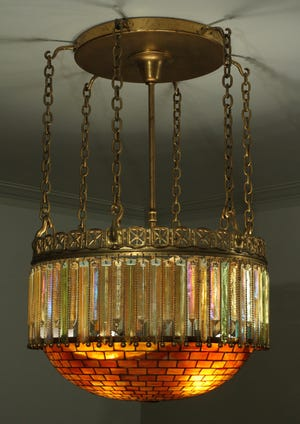 This amber-hued chandelier from New York's legendary Tiffany Studios once graced the dining room of the Horace Dodge estate in Grosse Pointe.