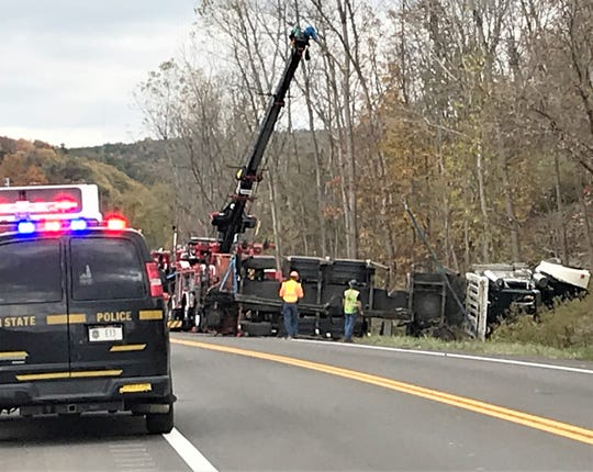 Crews work to remove an overturned tractor trailer from state Route 417 in the Steuben County Town of Erwin on Monday afternoon.