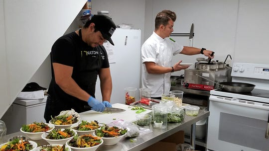 Cook Jorge Baquerizo and chef Adam Edwards in the kitchen at the Refinery on Friday, Oct. 4, 2019.