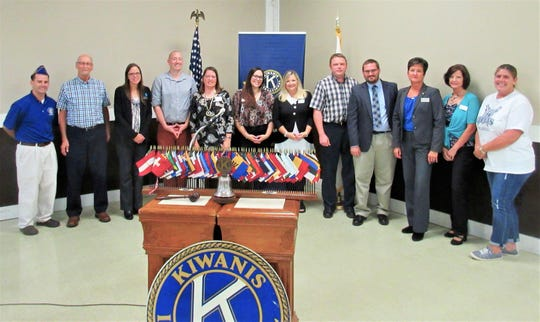 Left to right are Kiwanis members Mark Zeno, Rod Combs, Adrienne Fawsey, Alex Boroff, Linda Combs, Amanda Glick, Beth Rice, Rick Holland, Jordan Treece, Erin Cremean, Lisa Shuey, and  Angie Wood.