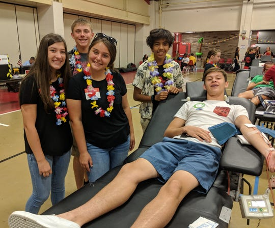 Port Clinton High School Future Professionals in Medicine members Makaila Webb, Ethan Carpenter, Jenna Hofacker, Diego Buhay, support blood donor Garrett Hirt during the recent American Red Cross  Bloodmobile at Port Clinton High School.