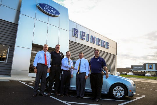 On Thursday, September 5, the Terra State Community College Power Technologies program accepted a late model vehicle donation from Reineke Family Dealerships. Pictured (L-R): Bill Reineke, Jim Distel, Cory Stine, Dan Reineke and Bill Taylor.