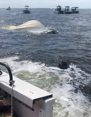 One man was killed and another was rescued after a boat taking on water capsized in Charlotte Harbor near Devilfish Key on Sunday, Oct. 13, 2019.