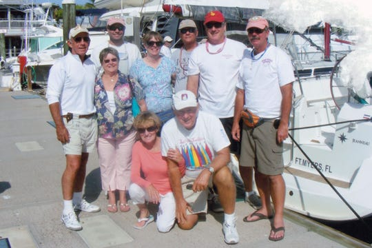 "Steve Romaine, picture with his crew, was honored with the title ""Mr. Summerset"" for his decades of fundraising for the Summerset Regatta."