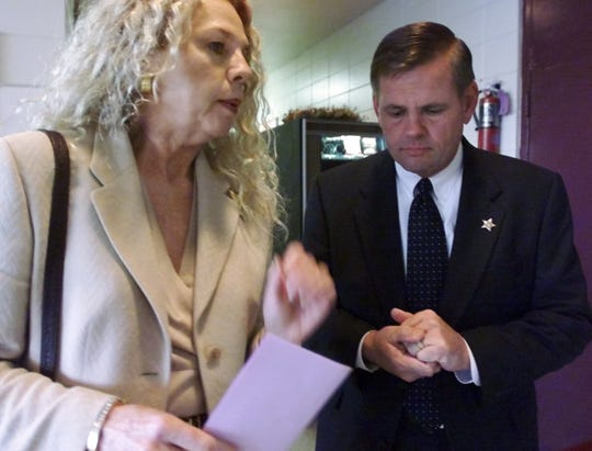 Lynda Van Bibber talks with then Lee County Sheriff Rod Shoap before the start of the Community Town Hall Meeting at the Dr. Carrie Robinson Center in January 2001. night. Bibber was Shoap's executive assistant.