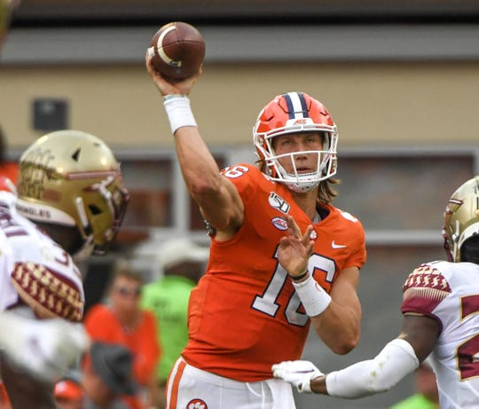 Clemson quarterback Trevor Lawrence (16) throws in the game with FSU during the first quarter at Memorial Stadium in Clemson, South Carolina Saturday, October 12, 2019.