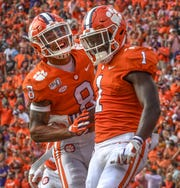 Clemson sophomore Derion Kendrick(1) celebrates with defensive back A.J. Terrell (8) after and interception and touchdown during the third quarter at Memorial Stadium in Clemson, South Carolina Saturday, October 12, 2019.