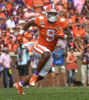 Clemson running back Travis Etienne (9) runs from Florida State defenders during the first quarter at Memorial Stadium in Clemson, South Carolina Saturday, October 12, 2019.