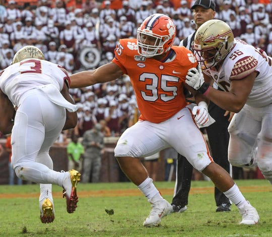 Clemson linebacker Justin Foster (35) reaches to tackle Florida State running back Cam Akers(3) during the third quarter at Memorial Stadium in Clemson, South Carolina Saturday, October 12, 2019.