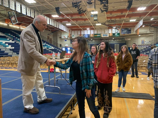 Katrina Lockart shakes Peter Metzelaar's hand as she thanks him for sharing his story at Great Falls High on Monday morning.