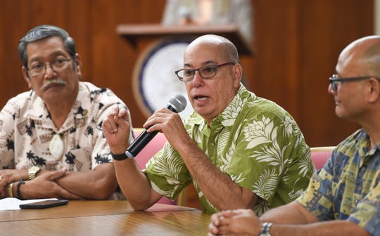 Guam Department of Labor Director David Dell'Isola discusses the signing of Bills 136 and 128 during a press conference at the Ricardo J. Bordallo Governor's Complex in Adelup, Oct. 14, 2019.
