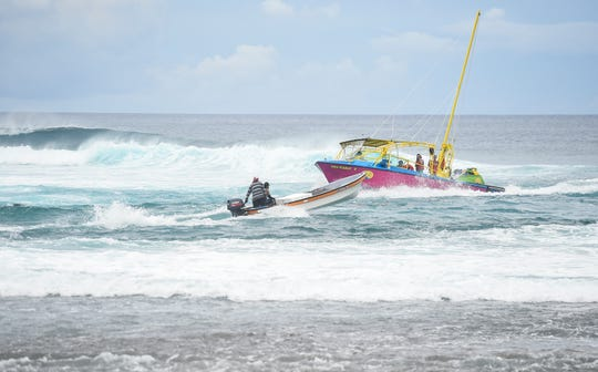 Watercrafts navigate through a rip current in Agana Bay on Oct. 14, 2019.