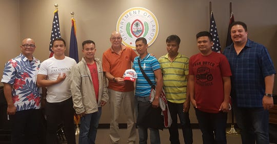 The Guam Department of Labor's Alien Labor Processing Certification Division acknowledged the registration of more than 1,000 H-2B workers in October. The number of H-2B workers hadn't surpassed 1,000 since 2016. From left: Labor Deputy Director Gerard Toves; Christopher Odvina, the 1,002nd H-2B worker; Marcelo Delgado, the 1004th H-2B worker; Labor Director David Dell'Isola; Randy Rosales, the 1,000th H-2B worker; Edwino Martinez, the 1,001st H-2B worker, Ericban Maglaque, the 1,003rd H-2B worker; Alien Labor Processing's administrator, Greg Massey.