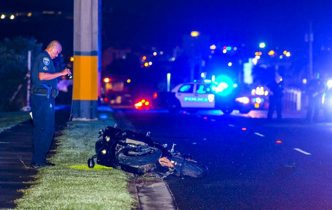 Guam Police Department officers conduct an investigation of a fatal motorcycle crash that occurred on Route 8, near the Government of Guam Retirement Fund in Maite, on Oct. 14, 2019.