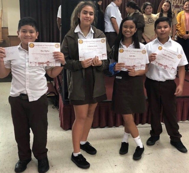 Mount Carmel Catholic School hosted their second annual Favorite Author and Novel Festival on Oct. 4 in the MCS Phoenix Hall.  Taking first place was Catherine Farrer, 8th grade; second place was Tabaaha Yellowhorse, 7th grade; in third place was Sofia Blas, 6th grade and Max Mafnas, 6th grade. From left: Max Mafnas, Catherine Farrer, Sofia Blas and Tabaaha Yellowhorse.