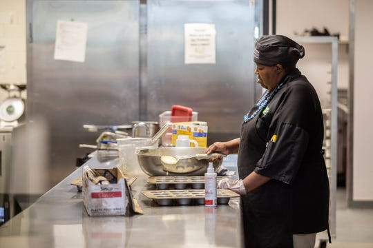 An employee prepares pretzels for students at Mississippi State University's Fresh Food Company dining facility Tuesday, October 9, 2019.