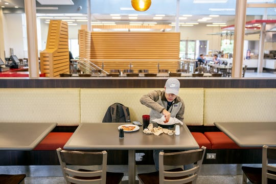 Evan Canon eats a meal in the Paul B. Johnson Commons at the University of Mississippi's Paul B. Johnson Commons at the University of Mississippi Monday, October 7, 2019.