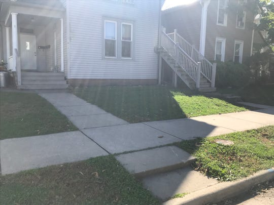 Reginald Lewis was standing near this step about 7:30 p.m. Sunday and talking with a group of men. One of those men shot Lewis in this spot, police said.