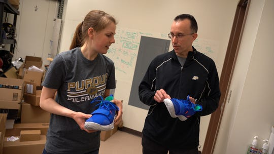 Eric Nauman, a professor of mechanical engineering, biomedical engineering and basic medical sciences at Purdue, reviews sports equipment with Brie Lawson, a mechanical engineering graduate student, in his Human Injury Research and Regenerative Technologies lab.  Nauman will conduct biomechanics research for the Ray Ewry Sports Engineering Center.