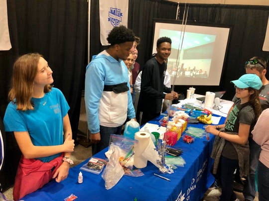 David Thibodaux STEM Magnet Academy students in the biomedical magnet program help kids separate strawberry DNA in a demo during Magnet Academies Showcase Saturday, Oct. 12.