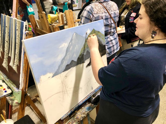 Comeaux High student Samantha Sigur paints as a demo for the Academy of Visual & Applied Arts during Magnet Academies Showcase Saturday, Oct. 12.