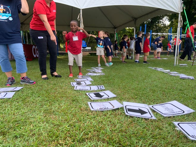 Woodvale Elementary students celebrate science through hands-on activities Friday, Oct. 11, at the Science Space Odyssey Symposium. Kids learn basic programming skills with hopscotch coding from CGI Federal.