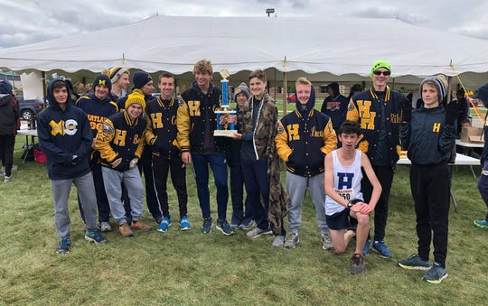 Hartland's boys celebrate a first-place finish in the Kayla O'Mara Invitational cross country meet in Goodrich.