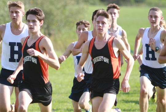 Brighton's Zach Stewart (front left) and Jack Spamer (center) and Hartland's Riley Hough (right) have easily surpassed the former Livingston County cross country record.
