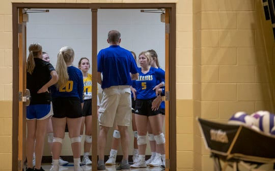 Christian Academy huddles in the hallway between sets, Tuesday, Oct. 8, 2019 in New Albany Ind.