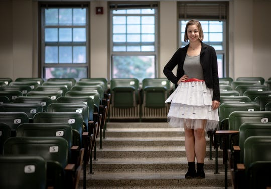 """I just searched for 'unfortunately' and 'we regret to inform you' in my email,"" Caitlin Kirby, a graduate student at MSU, said, while talking about finding material to make the skirt she created out of rejection letters she's collected applying for research journal publication entries, scholarships, and conference presentation proposals during her studies. She defended her Ph.D. dissertation in the handcrafted regalia, not in spite, but to show that rejection is a natural part of the process in achieving goals."