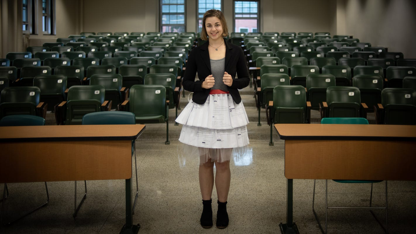 MSU student defends dissertation in skirt made of rejection letters