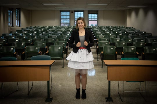 Caitlin Kirby, a graduate student at MSU, shows a skirt made of rejection letters she's collected rejecting her from research journal publications, scholarships, and conference presentations, Friday, October 11, 2019, in a lecture room in the Natural Sciences building on the campus of Michigan State University.  She defended her Ph.D. dissertation in the homemade regalia, to show that rejection is a natural part of the process in achieving goals.