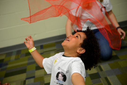 Zac Dunbar plays with a scarf during the RicStar's Music Camp on Monday, June 19, 2017 at the MSU Community Music School in East Lansing.