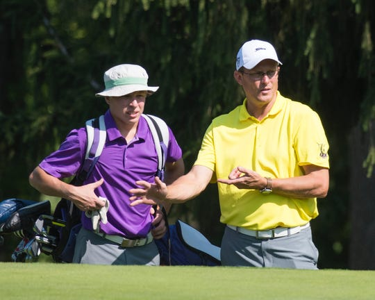 Lexington state qualifier Trevor Dials discusses strategy with coach Greg Smith during the Lex Shootout at Westbrook Country Club earlier this year .