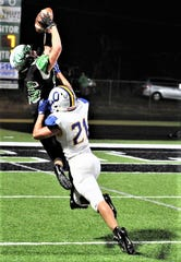 Clear Fork's Ashton Lyon goes up and over an Ontario defender for a catch during the Colts in over the Warriors last week.